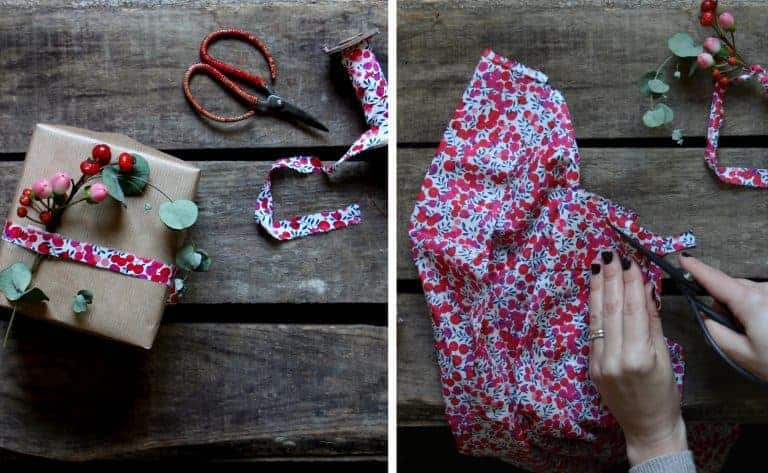 love this idea for making liberty fabric ribbon for christmas gift wrap with kraft brown paper and fresh berries and foliage. Click through for more ethical eco-friendly and plastic free christmas gift wrapping ideas you'll love to try