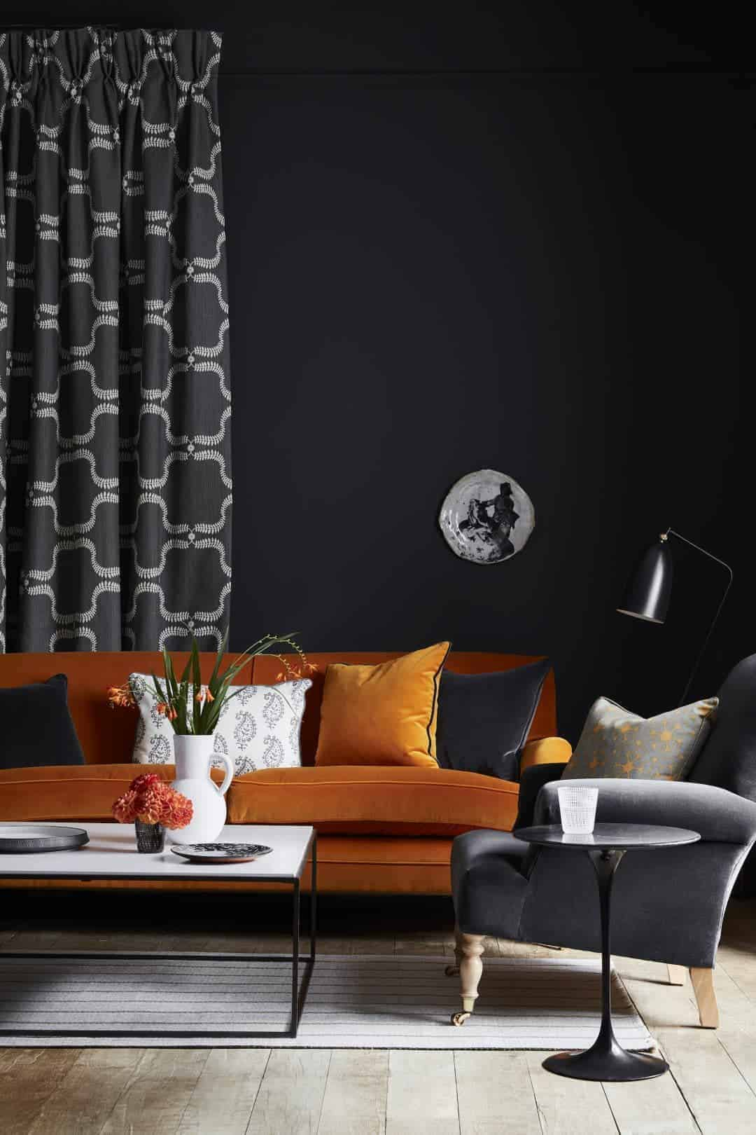 love this orange velvet sofa contrasted with printed grey and white linen curtains and cushion as well as black velvet and printed linen cushions. Click through for more velvet sofa velvet armchair and other velvet ideas you'll love