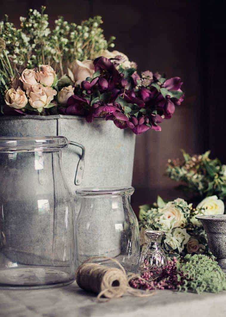 love this combination of purple hellebores, blush roses and lime white wax flowers with vintage galvanised zink and simple glass jars at Pod & Pip christmas flowers workshop. Click through for creative DIY christmas flower arrangement and table centrepiece ideas you'll love to try this holiday season