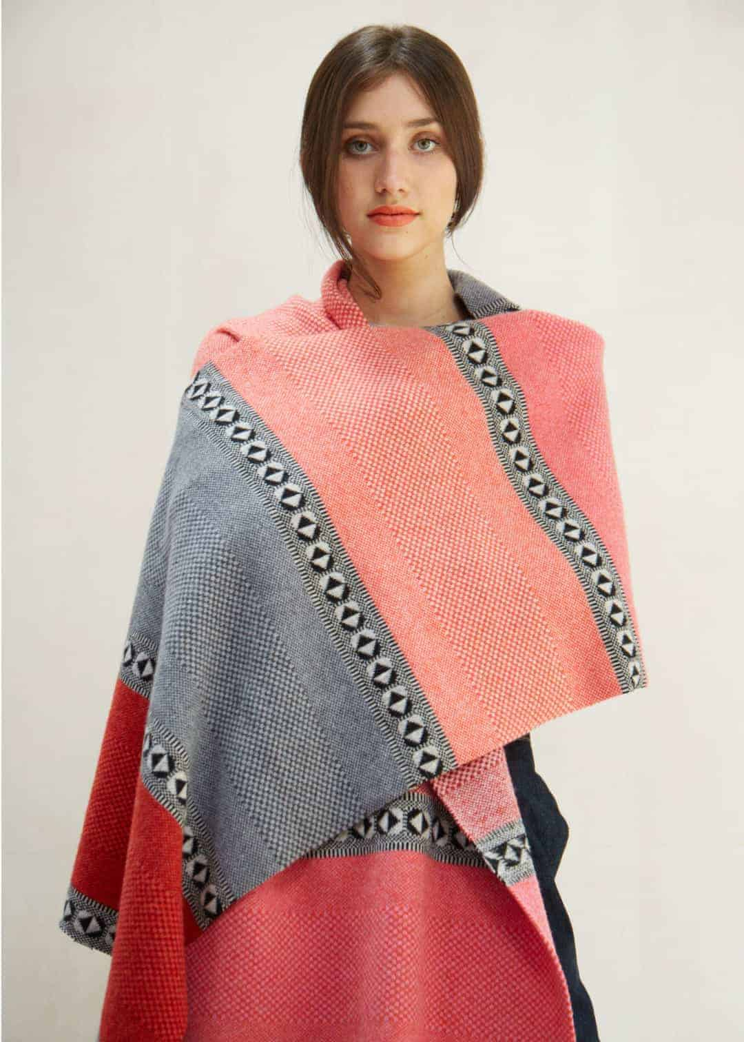 love this quinton chadwick blanket scarf made in Scotland from pure lambswool in red, grey and coral pink. Click through for more ethical gift ideas for Christmas you'll love #ShopEhicalInstead #ethicalgifts #madeinbritain #frombritainwithlove #sustainablegifts #ethicalhour #slowfashion #ethicalfashion