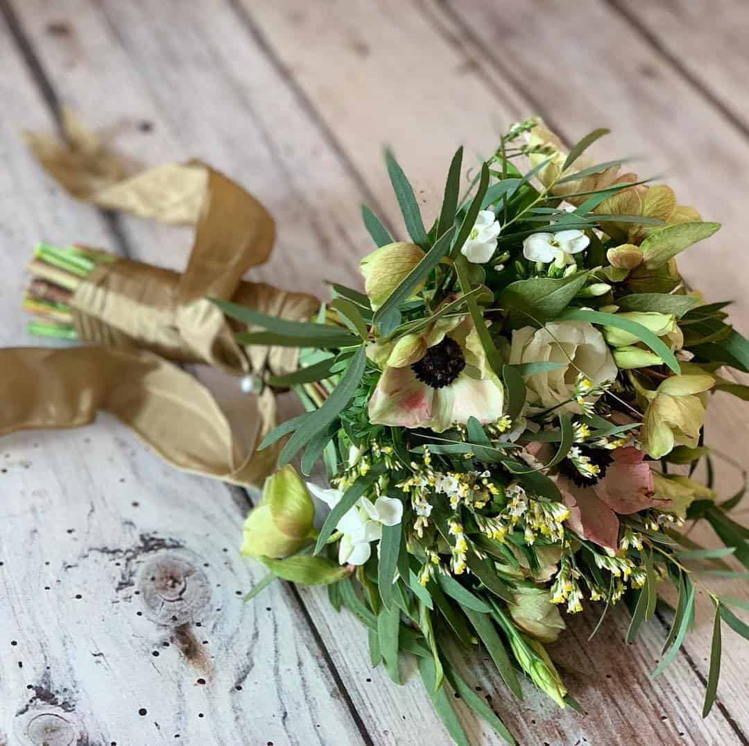 love this hand tied posy with spring flowers made at a Sussex Flower School workshop. click through to find out more and to discover founder of the school, Georgia Miles' inspirations, simple pleasures and local loves