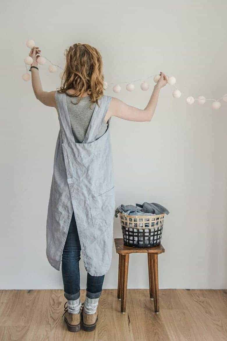 love this natural pale grey linen cross back japanese apron dress artisan apron sewing pattern by Verity Hope available to buy as a download on Etsy. Click through to get all the information you need #japaneseapron #crossbackapron #sewingpattern #sewing #diytutorial