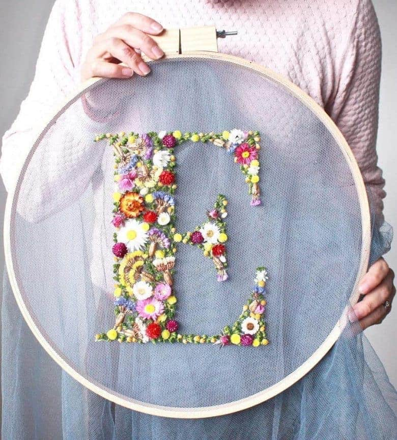 flower craft idea dried flower embroidery hoop art by olga prinku with step by step DIY tutorial and links to video tutorial #flowercrafts #frombritainwithlove #driedflower #embroidery #DIY #tutorial #hoopart