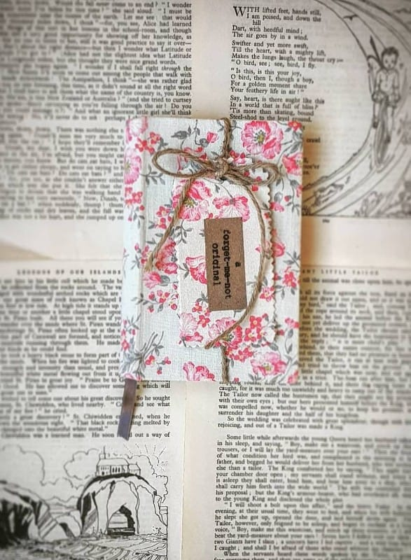 covered-vintage-books-notebooks.-pink-roses