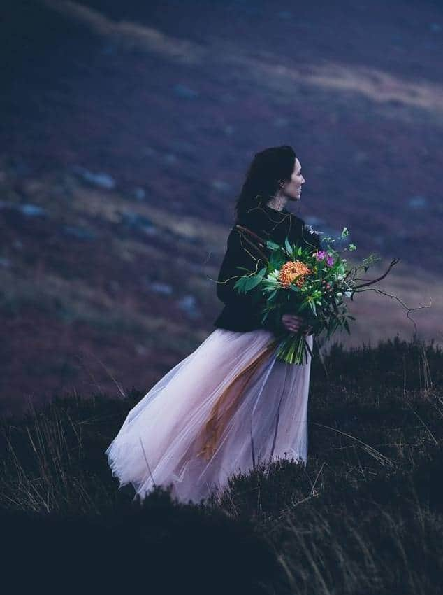 love this wild and romantic woman in landscape image by photographer Emma Davies. Click through photography tips and ideas for makers and creatives from hand-picked photographers as well as insider tried and tested ideas and contacts for great locations, stylists and online photography courses to help your photography stand out from the crowd #photographytips #creative #business #locations #photography #ideas #ayearwithmycameral