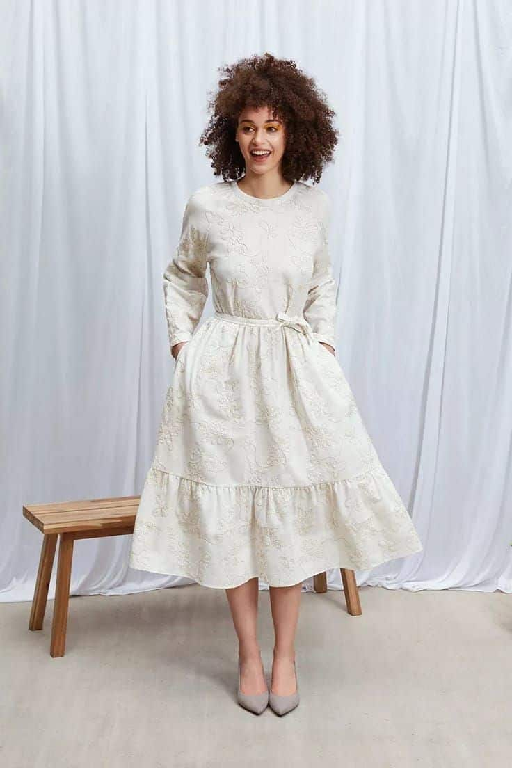 2 in 1 nora dress with detachable sleeves and removable belt so you can wear the dress loose or fitted. Made in the UK using upcycled deadstock embroidered fabric #deadstock #upcycled #sustainable #dress #madeinuk