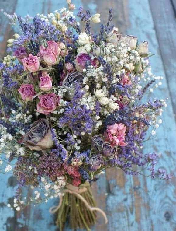 artisan dried bouquet with roses, lavender, larkspur and gypsophila. sustainably grown on the farm in Staffordshire.