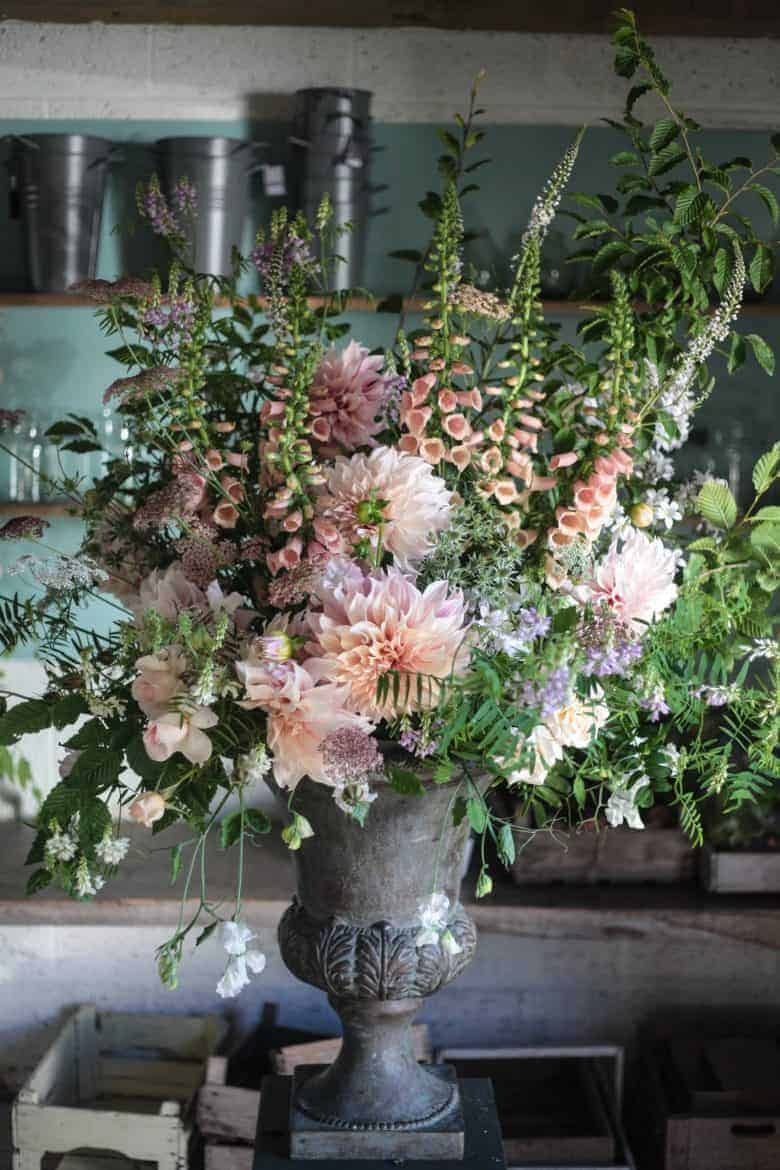 love this oversize vintage metal urn with country cottage garden blooms - foxgloves, dahlias, roses, salvia and sweet peas by green and gorgeous - sustainably grown in Oxfordshire - seasonal and naturally beautiful