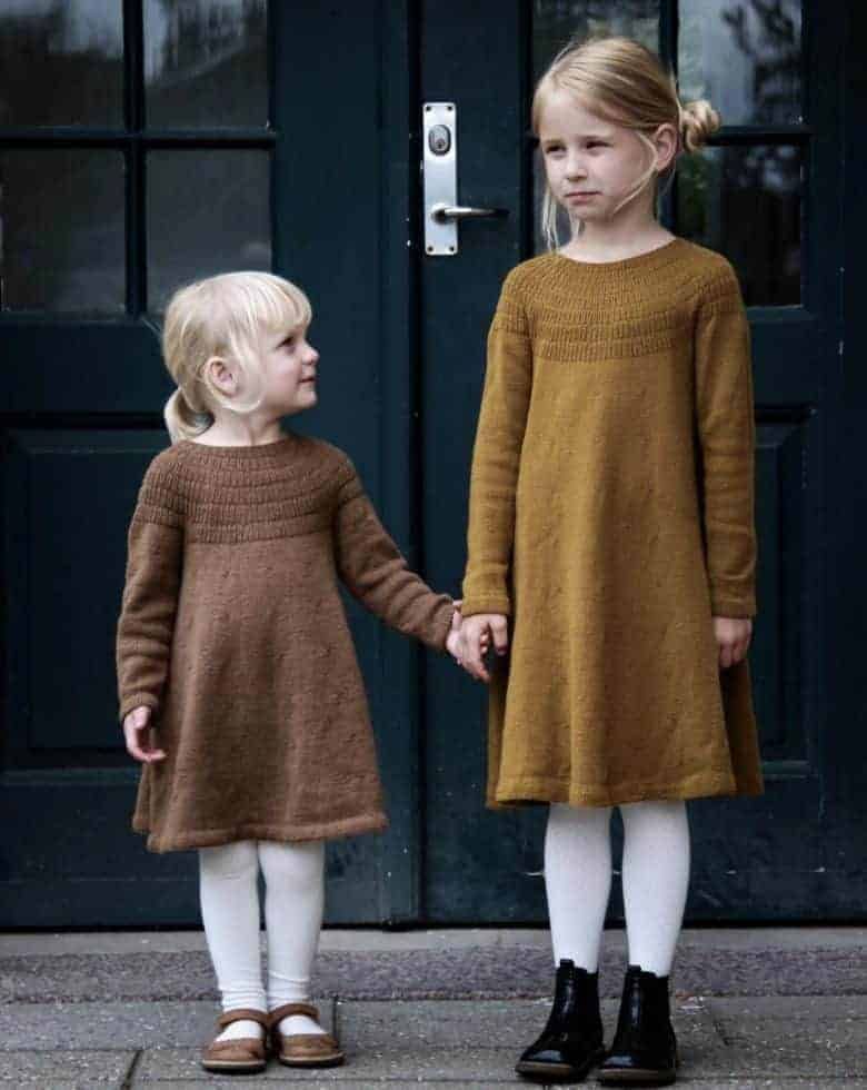 love this child's wool dress for little girls knitting pattern by petite knits. click through to find out where to get the pattern as well as to discover lots of other free knitting pattern ideas for autumn #knittingpattern #knitting #pattern #petiteknit #frombritainwithlove #autumn