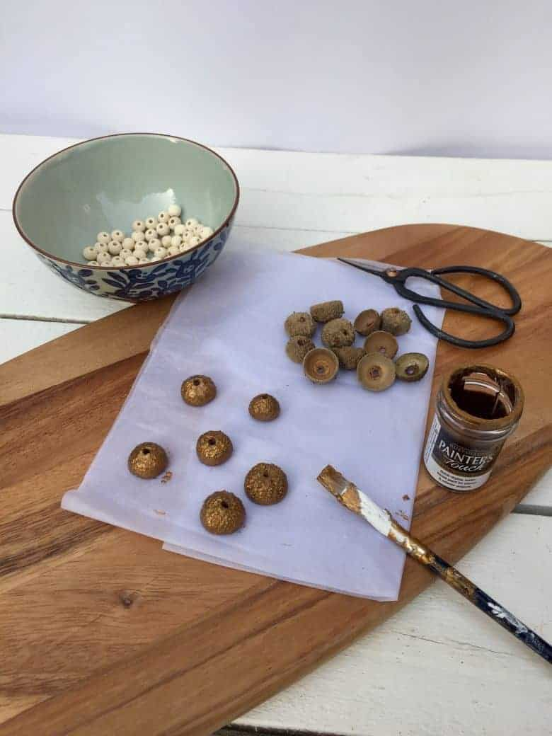 How to make Felted Acorns - step by step diy craft tutorial to show you how to make these lovely christmas decorations using foraged acorn tops, wooden beads and small felt wool balls #handmade #christmasdecorations #tutorial #diy #craftideas #craftychristmas #frombritainwithlove