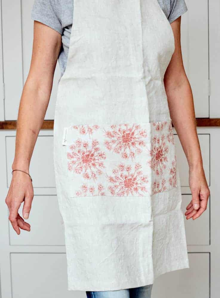 handmade linen cross back apron by Madder Cutch and Co using ethically printed linens. handmade christmas gift ideas for women made in Britain. Click through to discover other special ideas linen aprons, hand knits, personalised notebooks, baubles, hand-crafted jewellery, ethical natural beauty and more #handmadegifts #giftsforwomen #frombritainwithlove #madeinbritain #christmas gifts