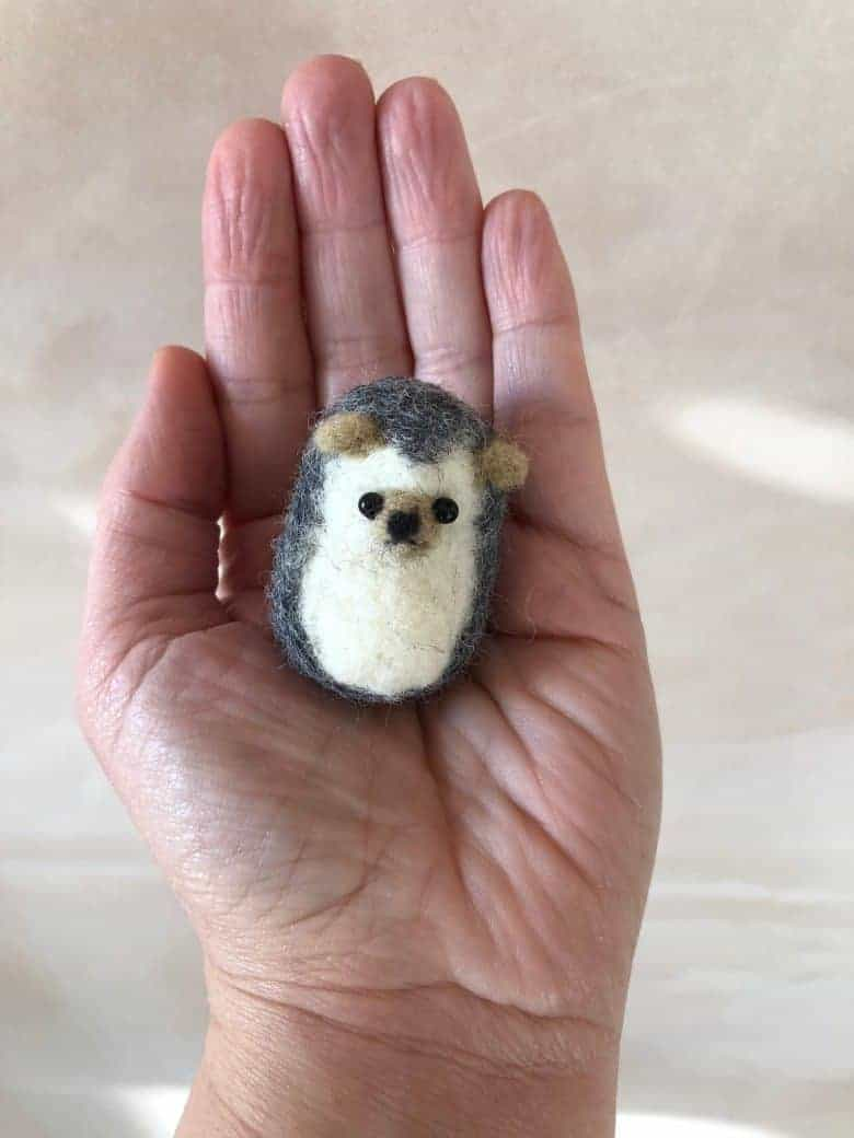 needle felted baby hedgehog sculpture by emma herian. handmade christmas gift ideas for women made in Britain. Click through to discover other special ideas linen aprons, hand knits, personalised notebooks, baubles, hand-crafted jewellery, ethical natural beauty and more #handmadegifts #giftsforwomen #frombritainwithlove #madeinbritain #christmas gifts