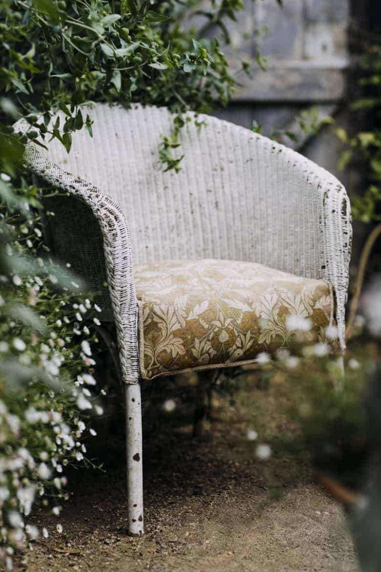 garden chair vintage wicker - flower photography tips and ideas from photographer Eva Nemeth including expert tips on how to create depth of field, work with light, texture, aperture and f stops to take beautiful flower and garden photographs #flowerphotography #photography #tips #frombritainwithlove #garden #chair