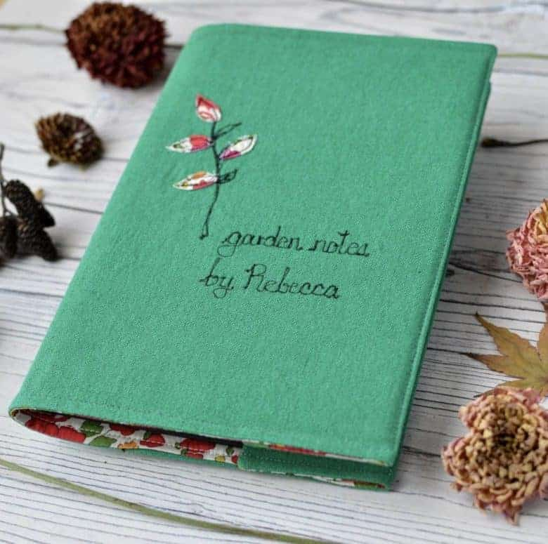 handmade personalised embroidered garden notebook by handmade at poshyarns. handmade christmas gift ideas for women made in Britain. Click through to discover other special ideas linen aprons, hand knits, personalised notebooks, baubles, hand-crafted jewellery, ethical natural beauty and more #handmadegifts #giftsforwomen #frombritainwithlove #madeinbritain #christmas gifts