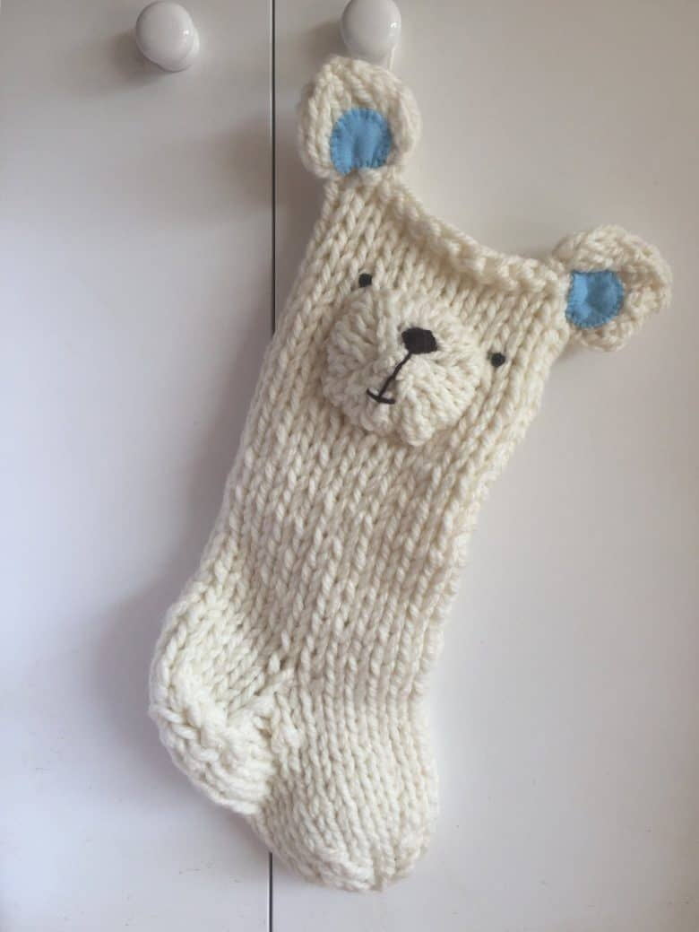 love this hand knitted christmas stocking polar bear by Laura Long. Click through to get the link to buy it on Etsy