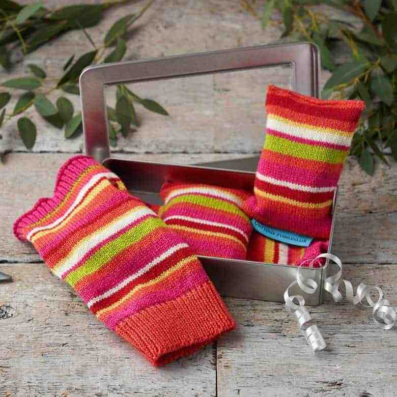 handmade stripey wool hand warmers and gloves by Curious Rose. handmade christmas gift ideas for women made in Britain. Click through to discover other special ideas linen aprons, hand knits, personalised notebooks, baubles, hand-crafted jewellery, ethical natural beauty and more #handmadegifts #giftsforwomen #frombritainwithlove #madeinbritain #christmas gifts