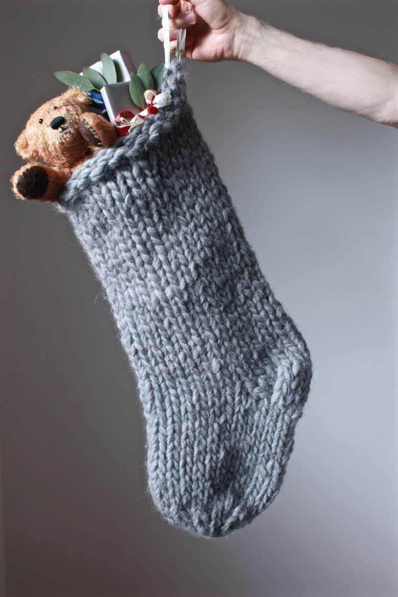 how to knit a christmas stocking - love this chunky stripy nordic style stocking in grey. Click through for expert tips and links to the perfect knitting pattern #knitting #christmas #stocking #decorations #holiday #craft #tutorial #DIY #knittingpattern #frombritainwithlove