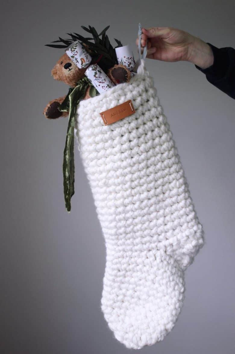love this christmas stocking giant crochet knitting pattern by olga prinku available to download from etsy and easy to make. Olga shares her expert tips and advice for making your own beautiful chunky christmas stockings for the holidays #chrismas #stocking #pattern #crochet