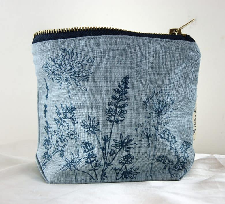 handmade blue linen embroidered make up bag by helen round from la juniper. handmade christmas gift ideas for women made in Britain. Click through to discover other special ideas linen aprons, hand knits, personalised notebooks, baubles, hand-crafted jewellery, ethical natural beauty and more #handmadegifts #giftsforwomen #frombritainwithlove #madeinbritain #christmas gifts