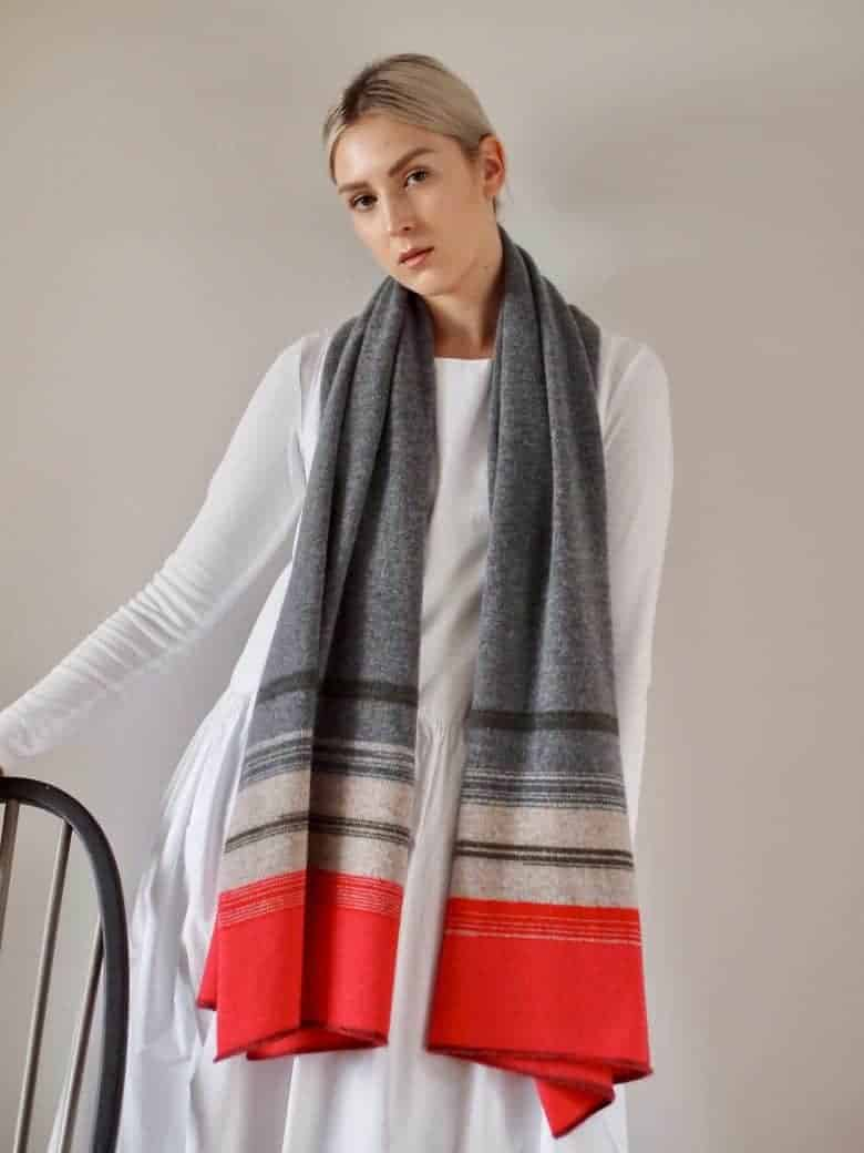 love this handcrafted lambswool striped grey and scarlet red wrap scarf by Jules Hogan. One of the special handmade gift ideas for women I've picked out to share with you. Click through for other ethically made and beautiful ideas you'll love #ethical #gifts #madeinbritain #sustainable #handmade #christmas