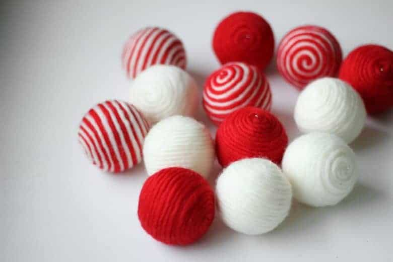 how to make stripy wool baubles. Click through for easy step by step tutorial to making these simple to make beautiful christmas decorations to love for years and years