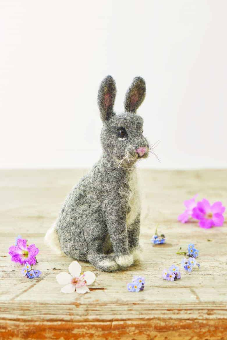how to make a needle felted rabbit or easter bunny. Click through for easy step by steps DIY tutorial by Emma Herian. It's easier than you might think! #needlefelted #bunny #needlefeltedanimals #needlefelt #frombritainwithlove