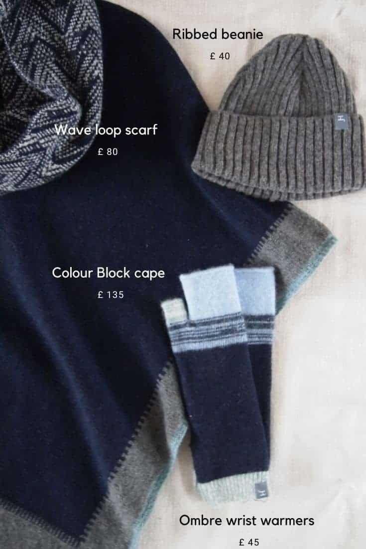 love this navy blue grey and pale blue striped and ombre cape wrap matching wrist warmers, scarf and beanie hat by jules hogan hand crafted british knitwear #knitwear #madeinbritain #frombritainwithlove #stripes