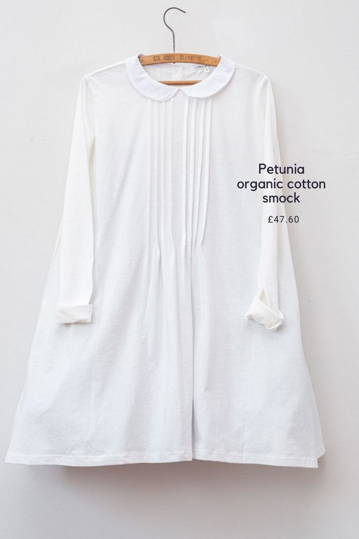 Love this pure white organic cotton smock dress with peter pan collar and pin tucks with long sleeves made in england by ethical british fashion designers Cabbages & Roses #sustainablefashion #slowfashion #madeinengland #organic #whitecotton #cabbagesandroses
