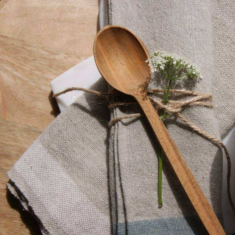 sustainable wood spoon handmade in wales using cherry wood - approximately tea spoon size, and will arrive wrapped in ethically sourced tissue. Made from sustainable cherry wood and made by families in Slovenia and Wales, collated by a Welsh family business #wood #spoon #sustainable #handmade