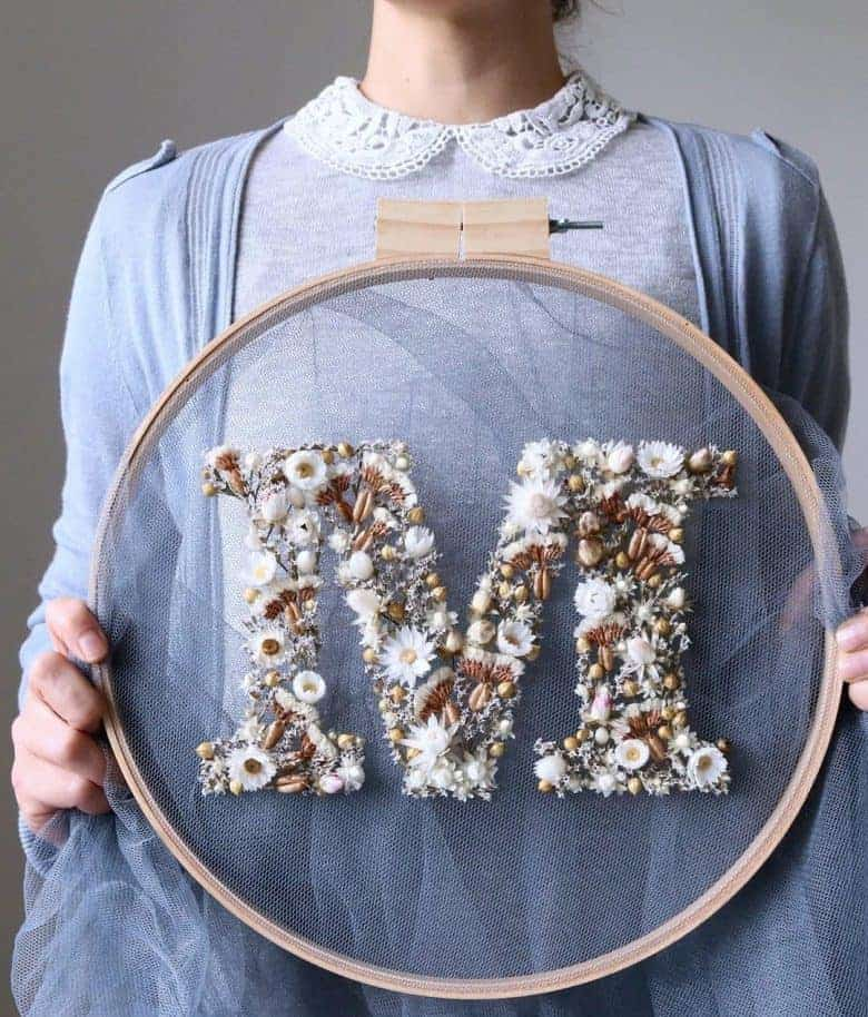 olga prinku dried flower embroidery hoop art initial monogram letter on tulle in embroidery hoop