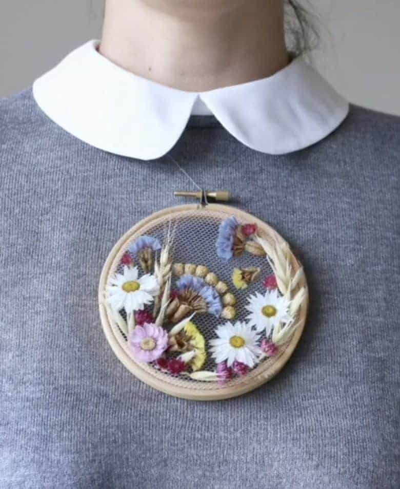 lockdown craft idea: dried flower embroidery hoop art necklace with pink and yellow dried flowers #driedflowers #hoopart #lockdown #craftideas #frombritainwithlove