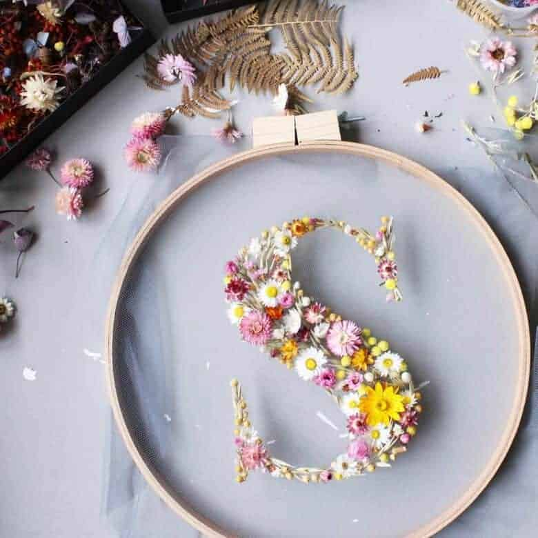 dried flower hoop art embroidery intial monogram letter s with pink and yellow dried flowers #driedflowers #hoopart #lockdown #craftideas #frombritainwithlove