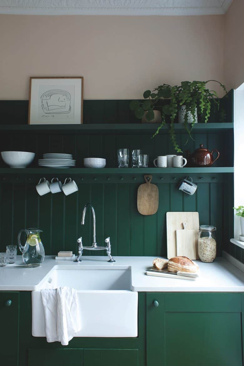 love this rustic dark green and white kitchen painted in Duck Green paint by Farrow & Ball to create a vintage country modern rustic kitchen feel with white butler belfast sink and open shelving. Just one of the stunning ideas I've shared #farrowandball #kitchen #rustic #duck #green #paint #kitchen #modernrustic