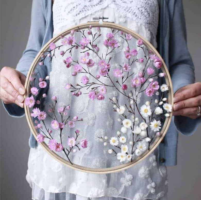 flower craft idea dried flower embroidery hoop art by olga prinku with links to video tutorial and blog post with step by steps #flowercrafts #frombritainwithlove #driedflower #hoopart