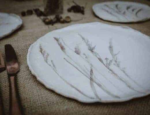 meadow grass print ceramics by julie reilly for these to hands - handcrafted in England with the imprint of wild grasses with ruffled edges and glazed with a cream-white and oxides to highlight the pattern in stoneware clay #meadow #grass #ceramic #plate #juliereilly #handmade