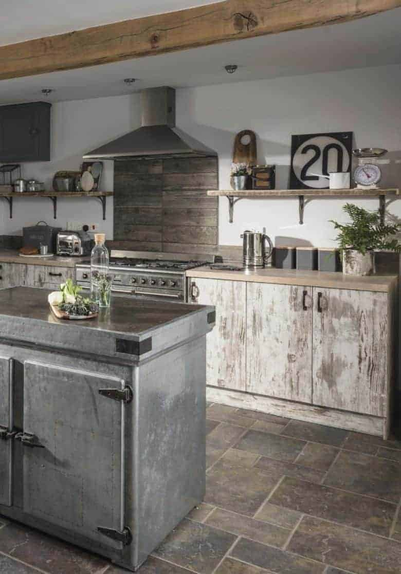 love this modern rustic kitchen idea with distressed wood kitchen units, open shelves, zinc metal vintage food store as island and vintage finds to add individuality. It's from one of the beautiful Unique Home Stays holiday properties - I've shared the link to book this one in Devon too! #modern #rustic #kitchen #ideas