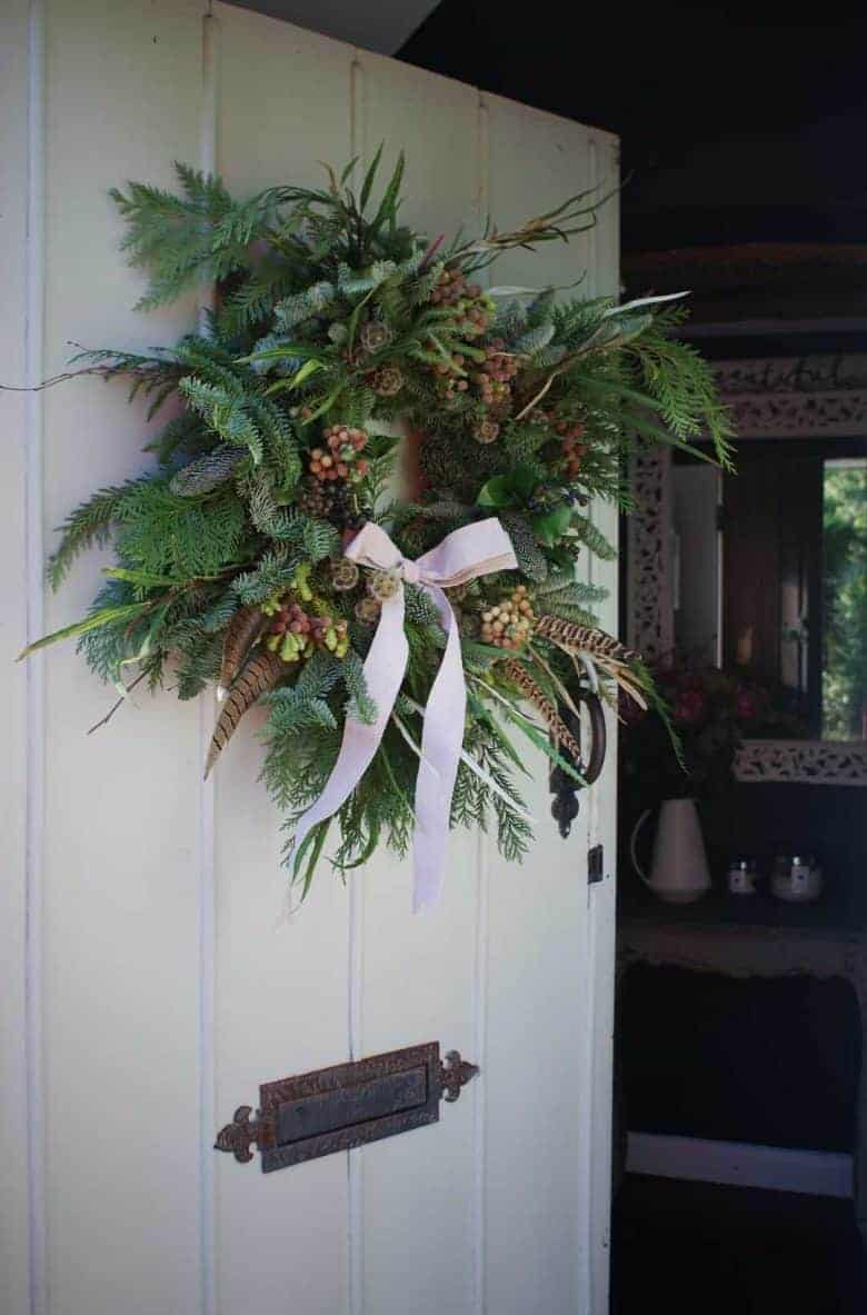 how to make a fresh christmas wreath for your door - I share my favourite ideas and step by steps to creating a holiday wreath or christmas wreath you'll love - from fresh and abundant to simple and classic, dried white flowers, giant wreaths and more #christmaswreath #holidays #wreath #flowers #diy #tutorial