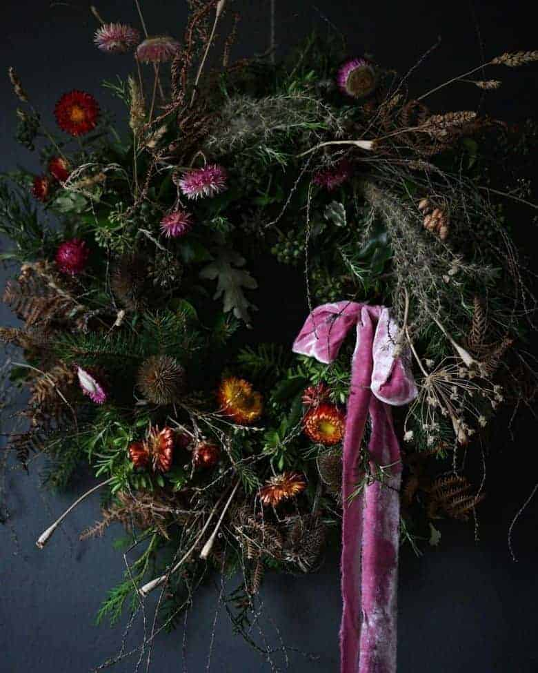 make a fresh and dried flower christmas wreath - we share step by steps as well as the info you need to book up a virtual workshop with Leigh Chappell and Jane Ford using sustainable ingredients and combining fresh and dried maybe like these straw flowers. Love the ribbon naturally dyed by The Natural Dye Works #christmas #wreath #sutainable #dried #diy #tutorial