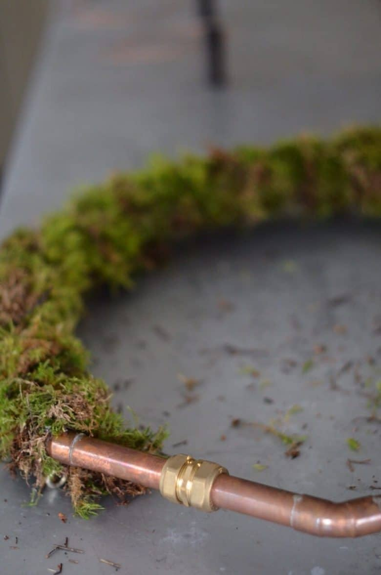 copper pipe base with moss giant christmas wreath