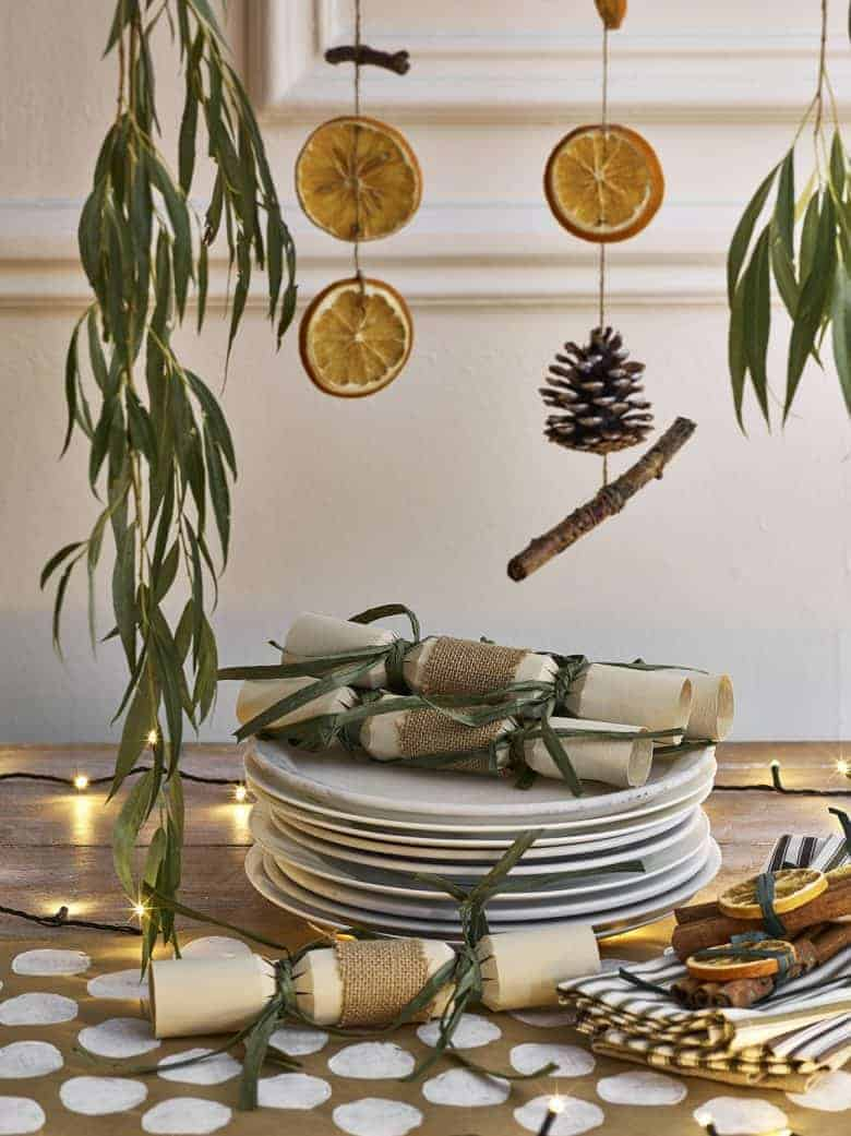 dried orange pine cone hanging christmas decoration by Annie Sloan click through for details to make it yourself as well as other creative and beautiful christmas wreath ideas #christmas #wreath #decorations #diy #tutorial