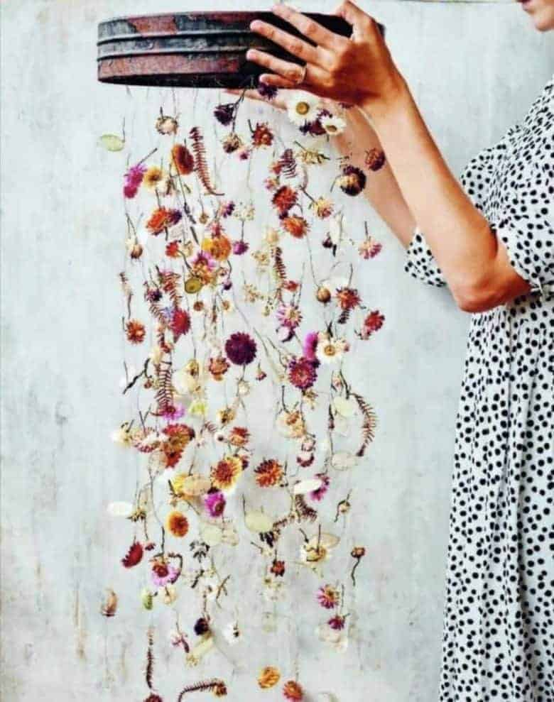 dried flower hanging decoration by bex partridge from her everlastings book and made with vintage riddle, dried everlastings and fine thread. Just one of the beautiful dried flower wreath and dried flower decoration ideas we've shared #dried #flowers #driedflowerwreath #utorial