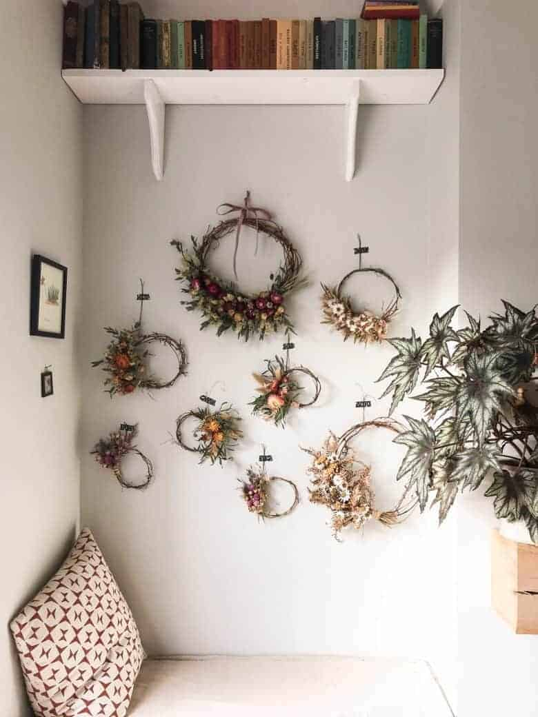 dried flower wreaths hanging on wall love these by bex of botanical tales. Click through to find out how to buy them ready made or make your own with Bex' book as well as lots of other creative ideas and step by step tutorial to make your own #dried #flowers #wreath #diytutorial