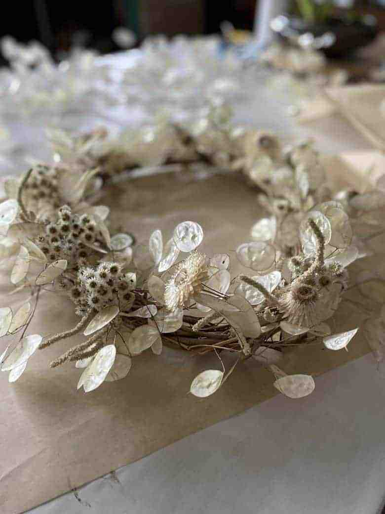 make a dried flower christmas wreath using honesty, dried white flowers and wisteria twigs for the base. click through for step by steps from Kirsten of Henthorn Farm Flowers. I've also shared lots of other Christmas wreath ideas to inspire you #christmaswreath #driedflowers #tutorial #holiday #wreath