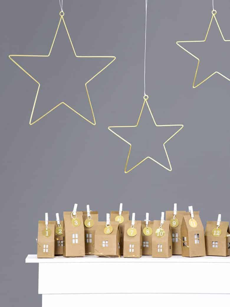 diy advent calendars - our pick of the most beautiful advent calendar kits to enjoy making this Christmas and to love for years to come like these beautiful kraft paper houses from etsy #advent #calendar #diy #frombritainwithlove #handmade