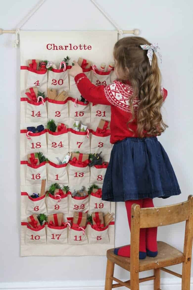 fill your own fabric advent calendar in unbleached cotton embroidered with personalised name as well as the 24 days of Christmas from etsy #advent #calendar #diy #frombritainwithlove #handmade