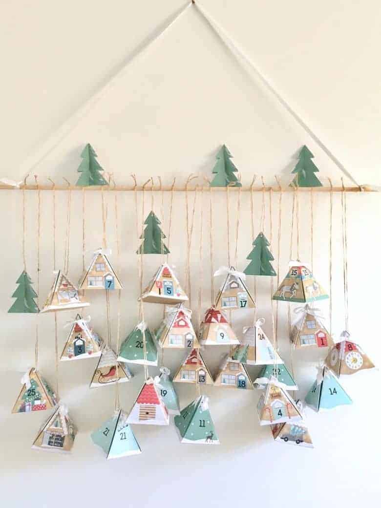 diy advent calendars - our pick of the most beautiful advent calendar kits to enjoy making this Christmas and to love for years to come like these beautiful fillable paper houses from etsy #advent #calendar #diy #frombritainwithlove #handmade