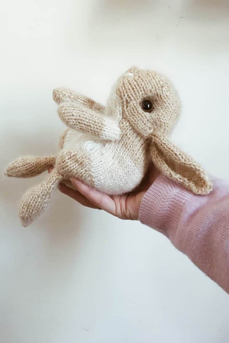 free spring bunny rabbit knitting pattern by claire garland aka dot pebbles knits - the perfect craft project for the season and free - just one beautiful seasonal craft idea I've shared #spring #craft #idea #bunny #rabbit #knitting