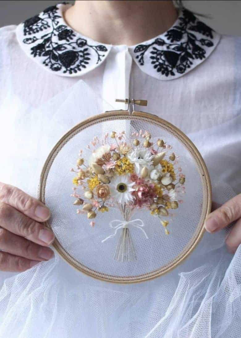 spring craft ideas to enjoy including dried flower embroidery on tulle embroidery hoop art - just one of the seasonal ideas to make this one by olga prinku #spring #craft #hoopart #embroidery #driedflowers