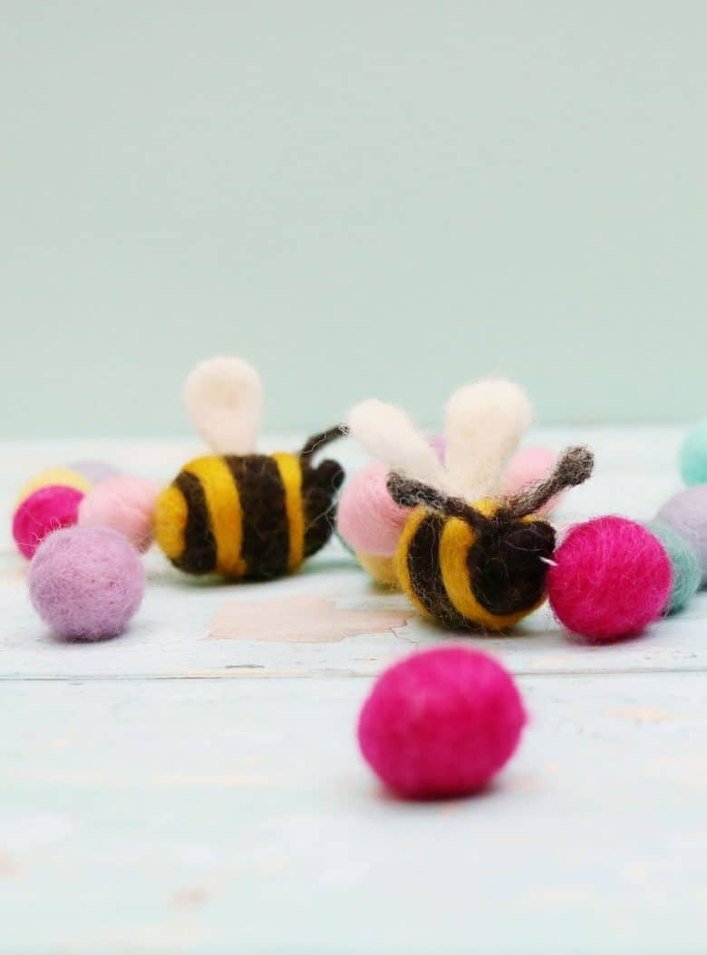 make a spring garland using felted balls and felted bumblebees - an easy craft idea by Sandy at Lincolnshire Fenn Crafts and easy to make. We share simple step by steps, video tutorial #spring #craft #felt #garland