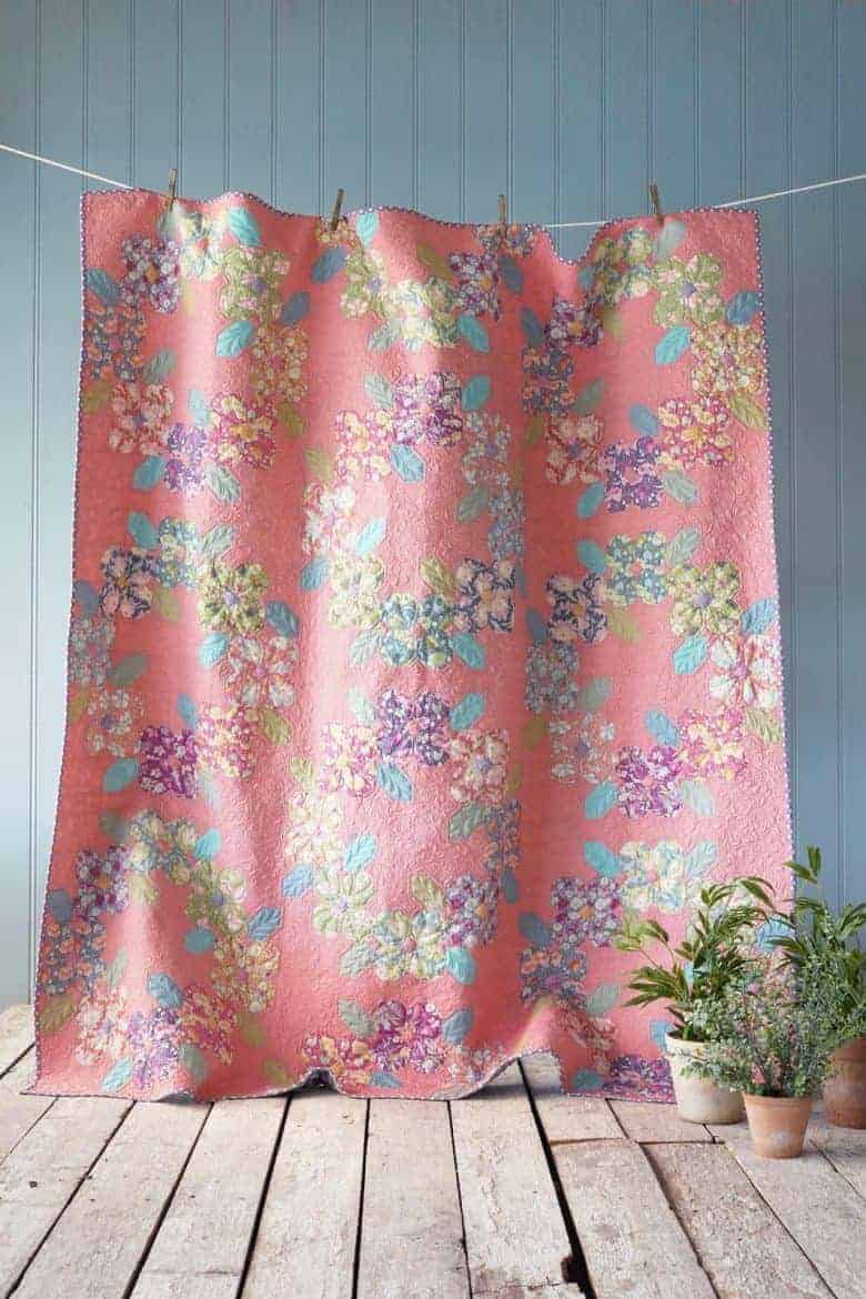 free patchwork quilt pattern Flower Wreath in Coral pinkfrom Tilda - get your free pattern download as well as all the links you need to source pretty fabric from the Gardenlife collection and beyond #patchwork #quilt #pattern #free